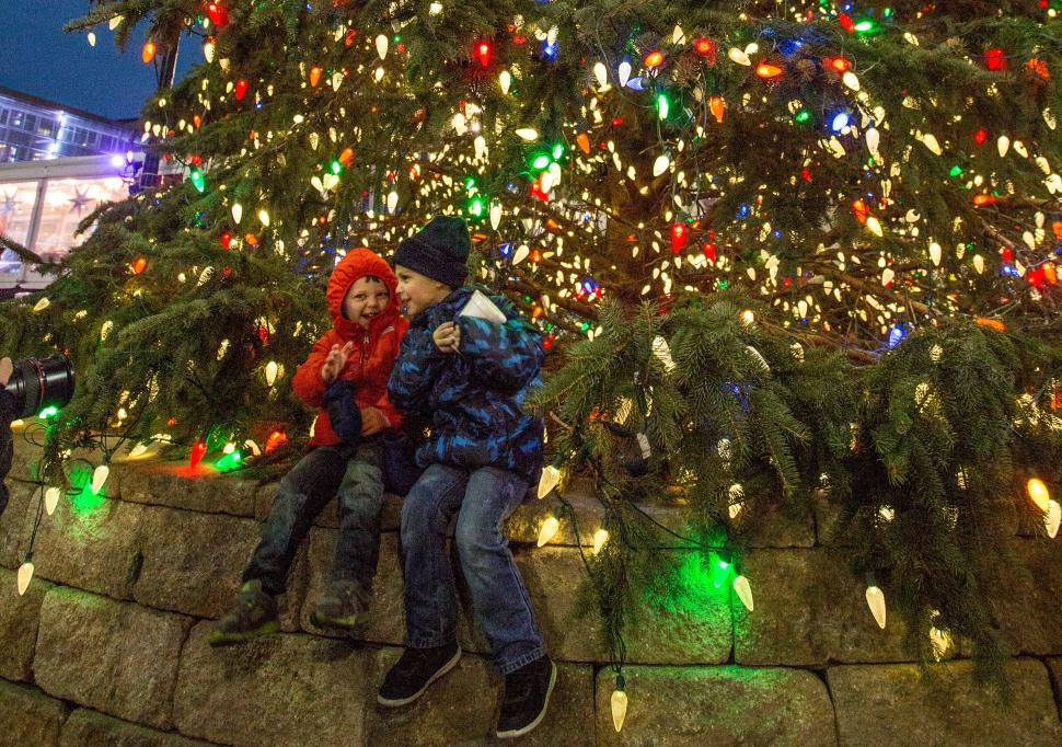 Kids enjoying the Fountain Square tree during the holidays