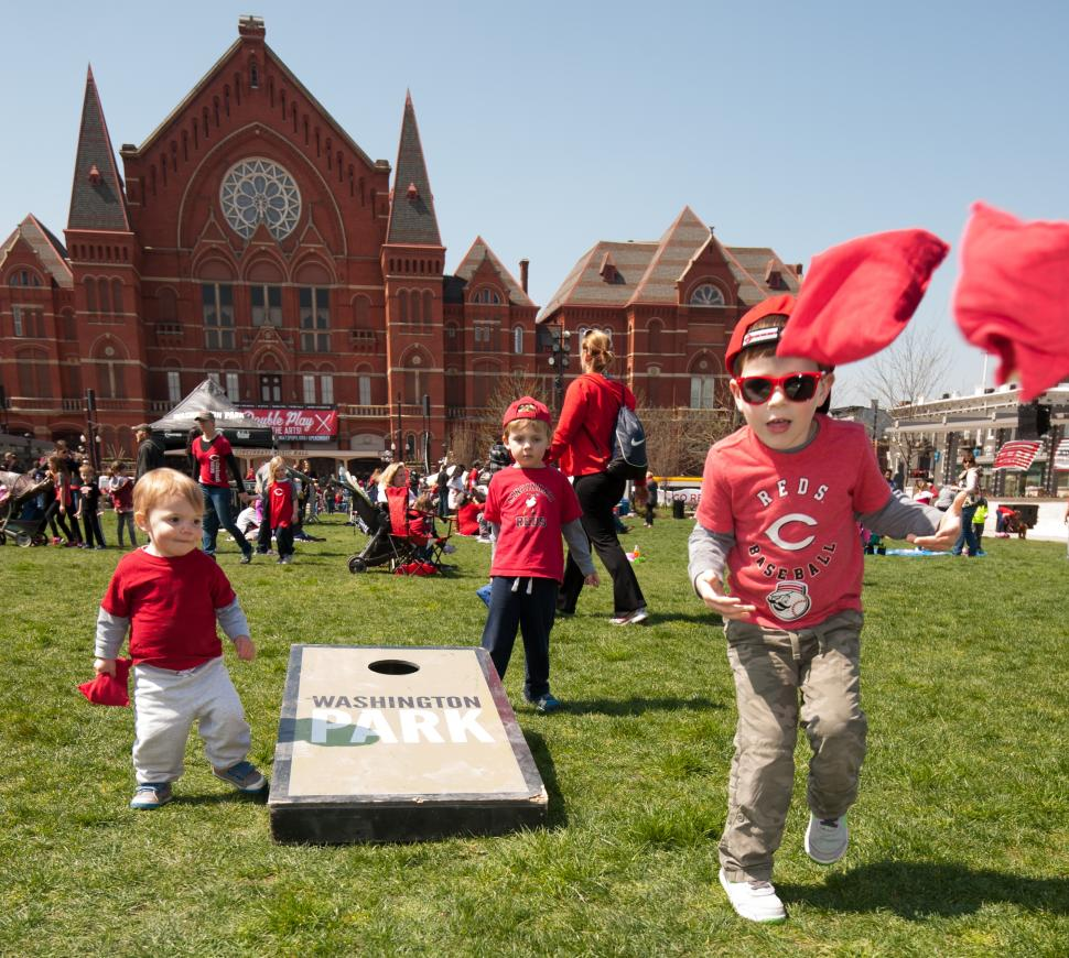 Kids playing cornhole during Reds Opening Day Celebration at Washington Park (photo: Lowry Photo)