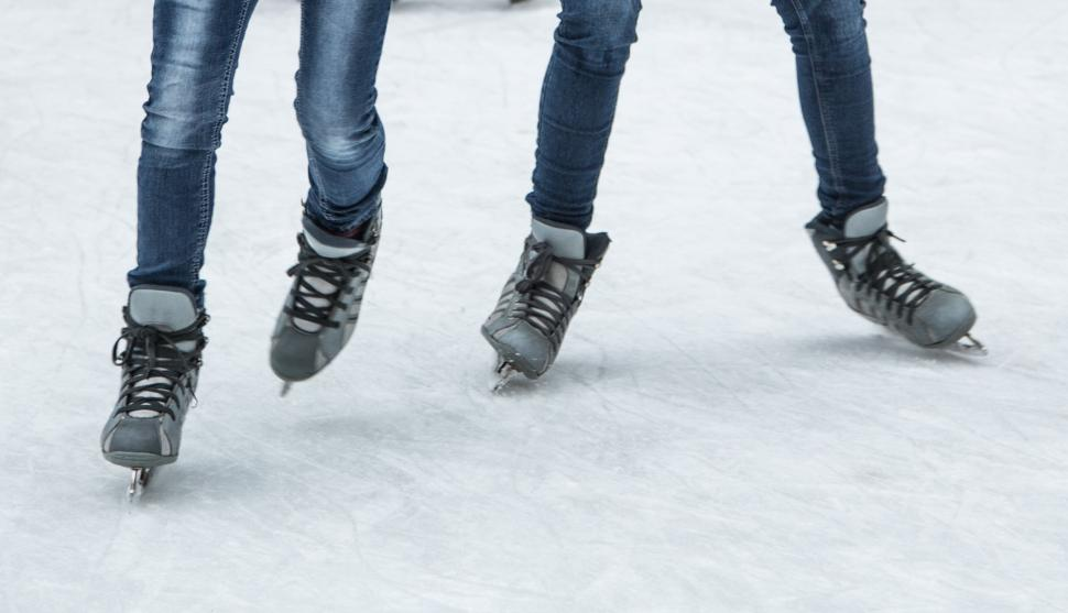 Close-up of ice skates on an ice rink (photo: CincinnatiUSA.com)