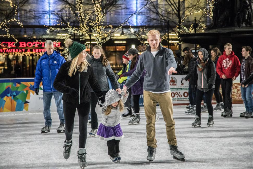 Family of three ice skating on Fountain Square (photo: CincinnatiUSA.com)