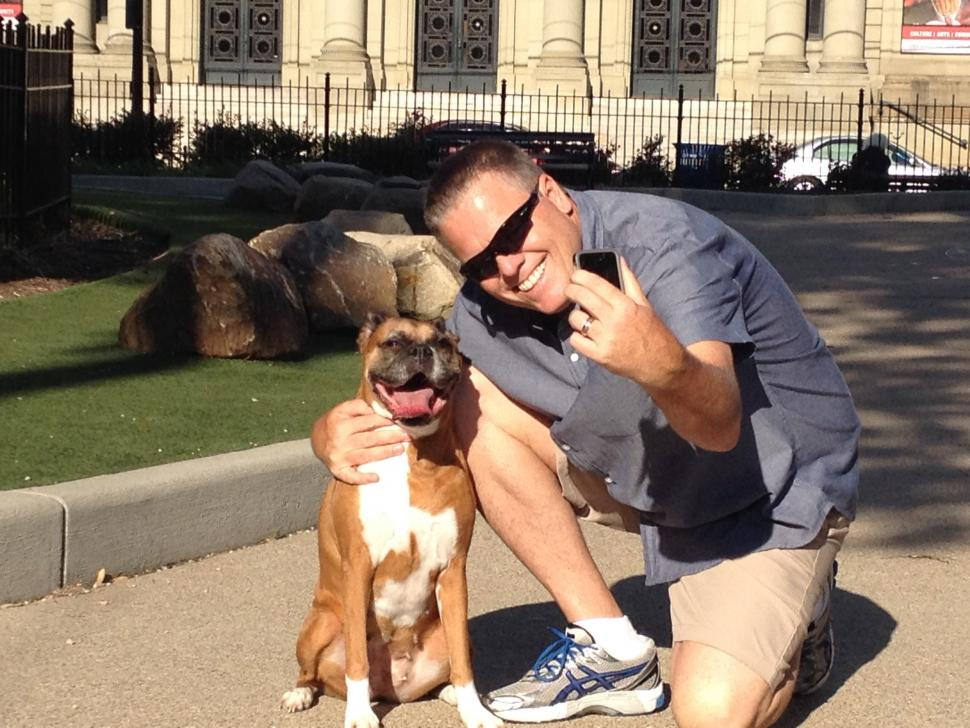 Jim Day takes a selfie with his pup in Washington Park