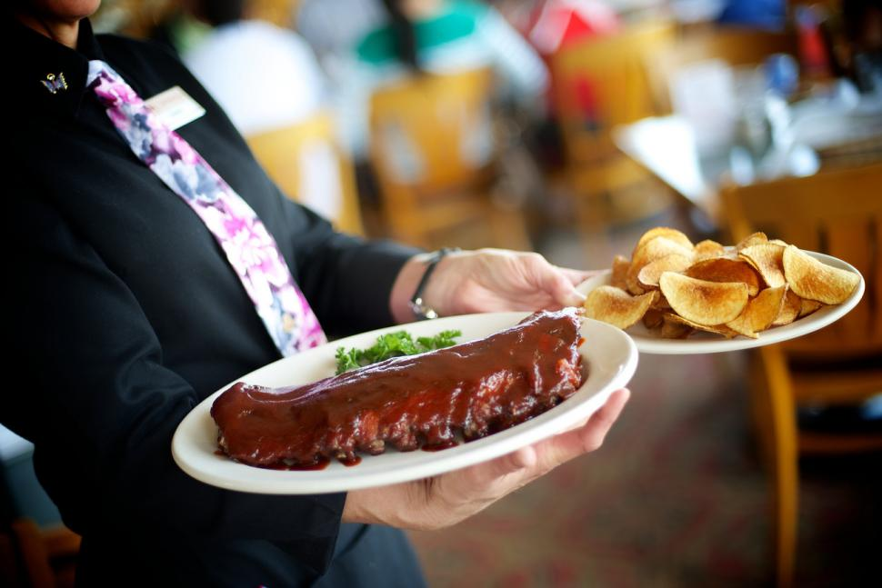 Server carrying ribs at Montgomery Inn (photo: Montgomery Inn)
