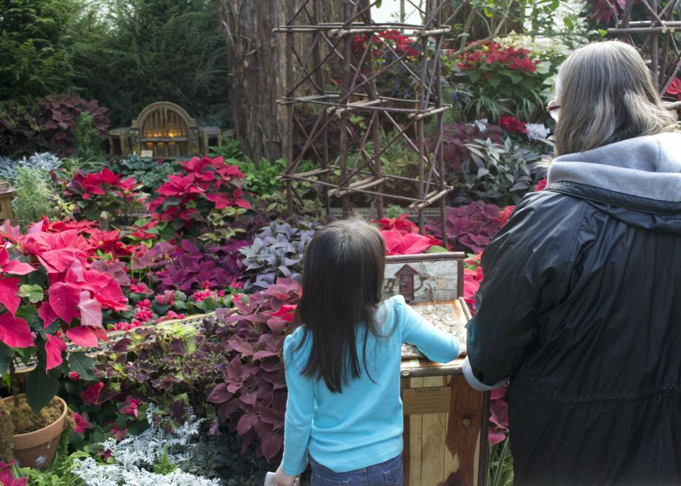 Girl and woman admiring the decor at the Krohn Conservatory holiday show (photo: Cincinnati Parks)