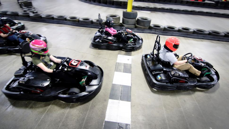 People enjoying indoor karting at Full Throttle.