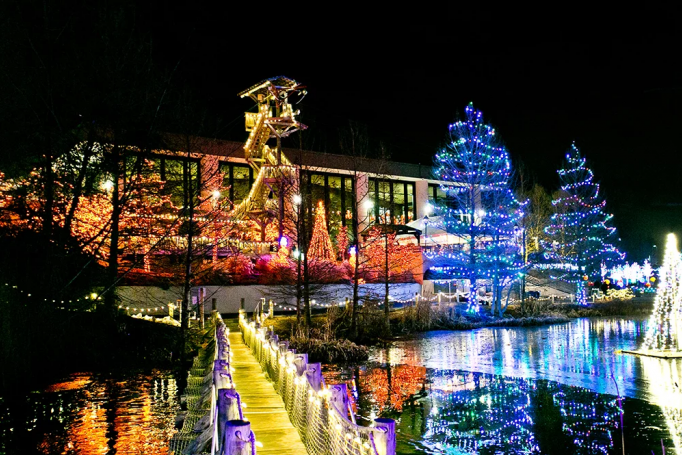 Exterior of Creation Museum lit up with holiday lights for ChristmasTown event.